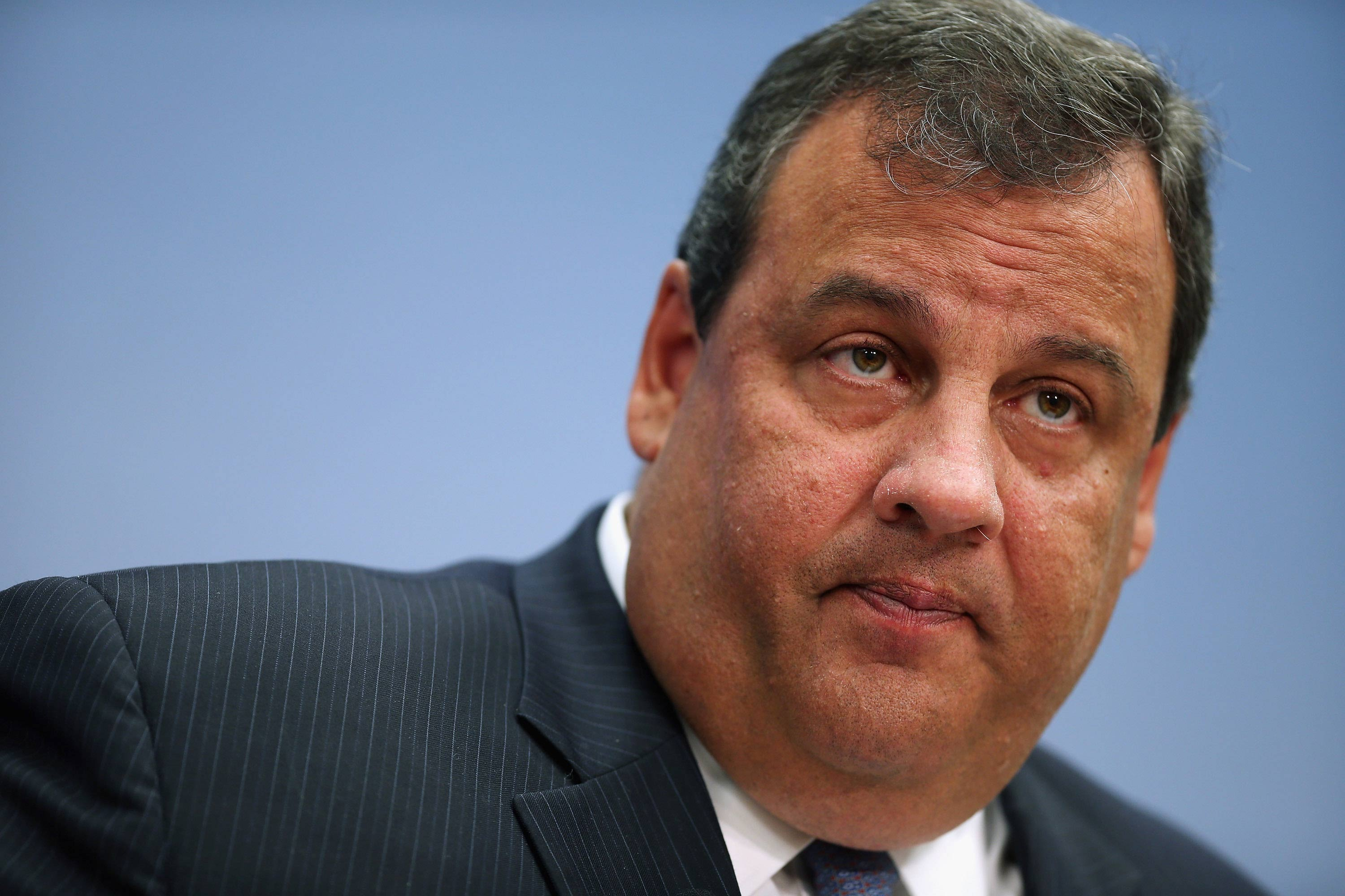 """WASHINGTON, DC - JULY 09:  New Jersey Gov. Chris Christie delivers remarks and answers questions at the Brookings Institution, a non-partisan, public policy think tank, July 9, 2012 in Washington, DC. Christie, whose name has been mentioned among possible GOP vice presidential choices, talked about his self-described """"New Jersey Comback,"""" and a fiscal record """"...including three balanced budgets, a two-percent hard cap on property taxes and landmark pension and health benefits reform.""""  (Photo by Chip Somodevilla/Getty Images)"""
